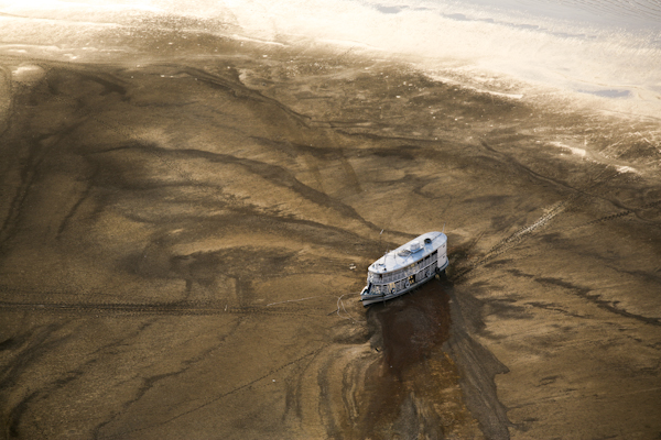 Big river boat trapped on a sand bank East of Barreirinha, Brazil, during one of the worst droughts ever recorded in the Amazon. ©Daniel Beltra