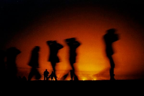 First Gulf War - Iraqi prisoners of war - shot at night against burning oil fires. ©David Leeson/The Dallas Morning News